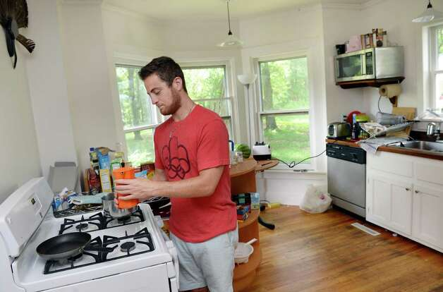 Ant Hill's head of partnershi[s Ethan Glass makes coffee in the kitchen of their Hacker House, where young entrepreneurs live and work Thursday July 2, 2015 in Saratoga Springs, NY.  (John Carl D'Annibale / Times Union) Photo: John Carl D'Annibale / 00032445A