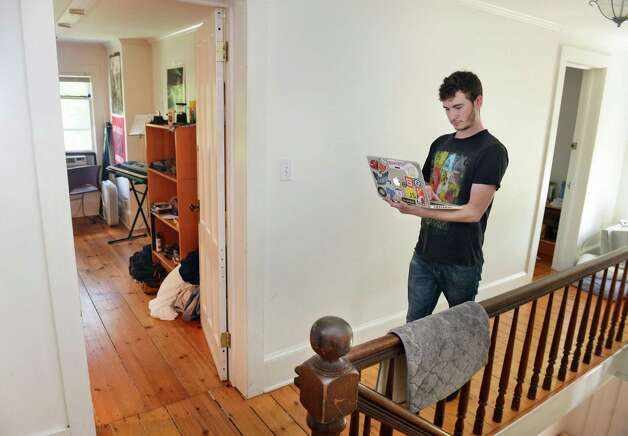 Ant Hill software developer Hunter Fortuin in the second floor living area of their Hacker House, where young entrepreneurs live and work Thursday July 2, 2015 in Saratoga Springs, NY.  (John Carl D'Annibale / Times Union) Photo: John Carl D'Annibale / 00032445A