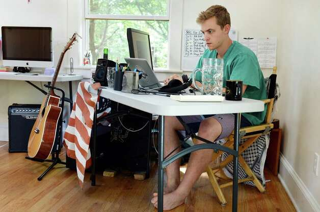 Ant Hill's head of product Matt Barth at his desk in the main office space of their Hacker House, where young entrepreneurs live and work Thursday July 2, 2015 in Saratoga Springs, NY.  (John Carl D'Annibale / Times Union) Photo: John Carl D'Annibale / 00032445A