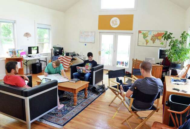 Ant Hill staffers in the main office space of their Hacker House, where young entrepreneurs live and work Thursday July 2, 2015 in Saratoga Springs, NY.  (John Carl D'Annibale / Times Union) Photo: John Carl D'Annibale / 00032445A