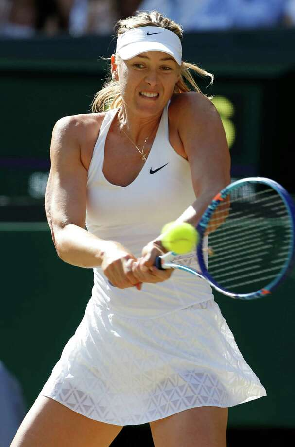 Maria Sharapova of Russia returns a shot to   Serena Williams of the United States  during the women's singles semifinal match at the All England Lawn Tennis Championships in Wimbledon, London, Thursday July 9, 2015. (AP Photo/Alastair Grant) ORG XMIT: WIM207 Photo: Alastair Grant / AP
