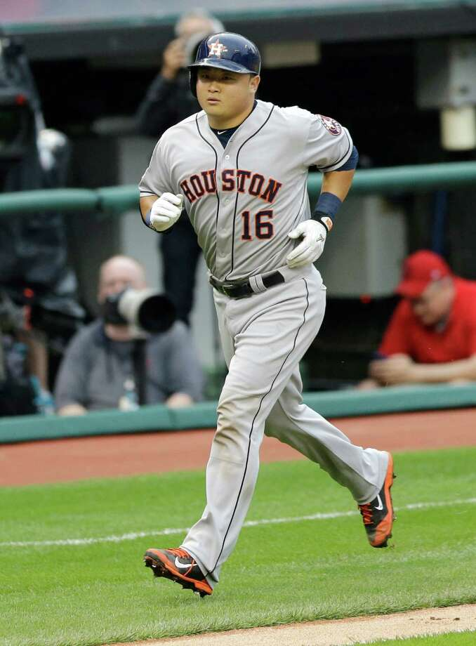 Catcher Hank Conger tours the bases after a third-inning solo home run that would end the Astros' scoring for the night. Photo: Tony Dejak, STF / AP