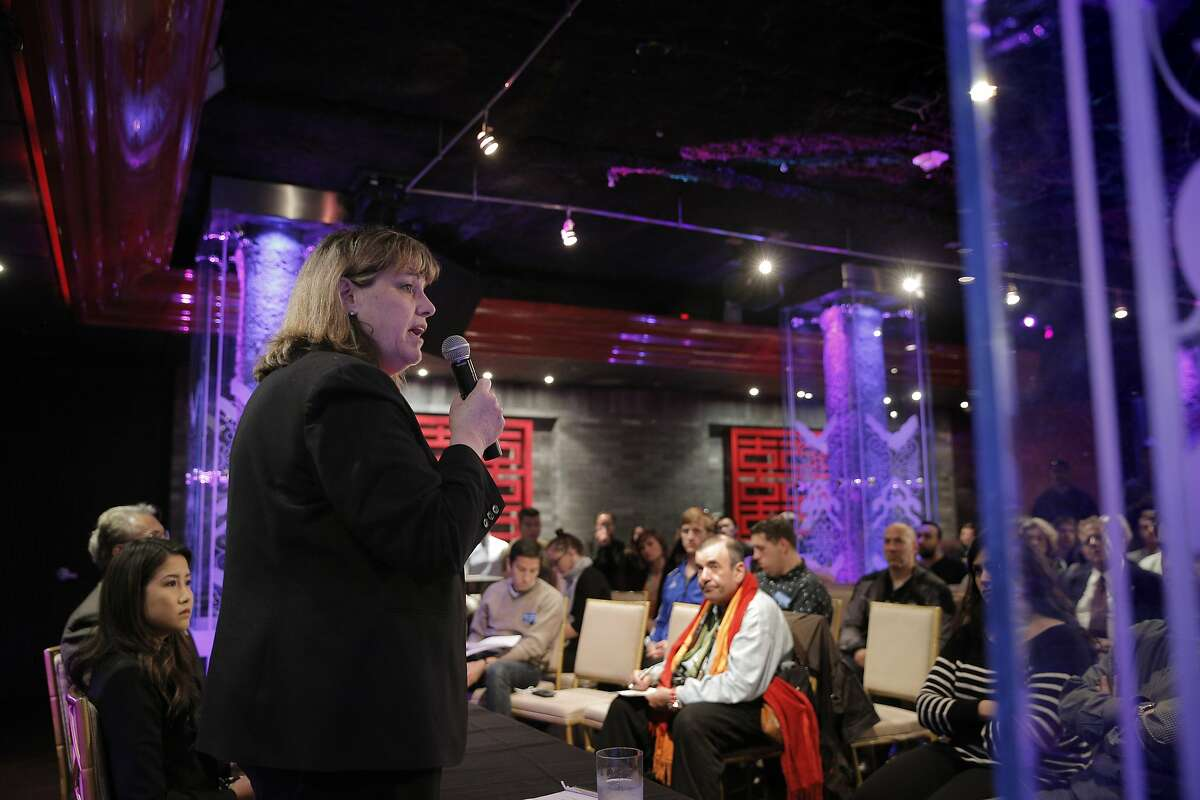 San Franciscoi Sheriff candidate Vicki Hennessy responds to a question during an election debate Thursday, that touched on San Francisco's sanctuary city laws. Candidates for San Francisco Sheriff, Vicki Hennessy and Ross Mirkarimi debated at Infusion Lounge in San Francisco, Calif., on Thursday, July 9, 2015.