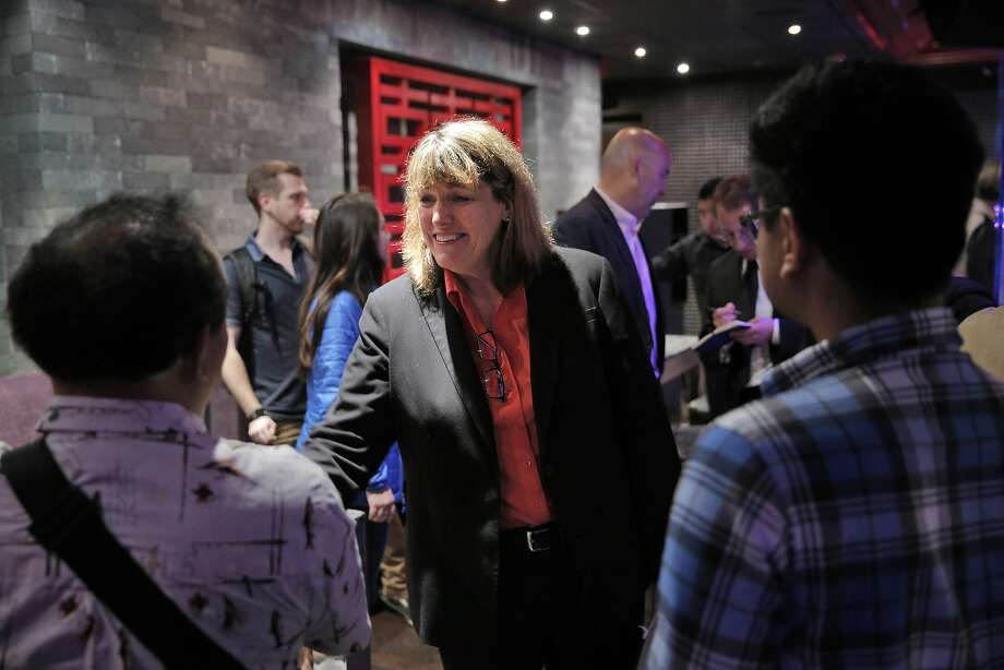 San Francisco Sheriff candidate, Vicki Hennessy, center, shakes hands with Michael Tong, left, and Mick Delrosario, right, after an election debate Thursday, that touched on San Francisco's sanctuary city laws. Candidates for San Francisco Sheriff, Vicki Hennessy and Ross Mirkarimi debated at Infusion Lounge in San Francisco, Calif., on Thursday, July 9, 2015. Photo: Carlos Avila Gonzalez, The Chronicle