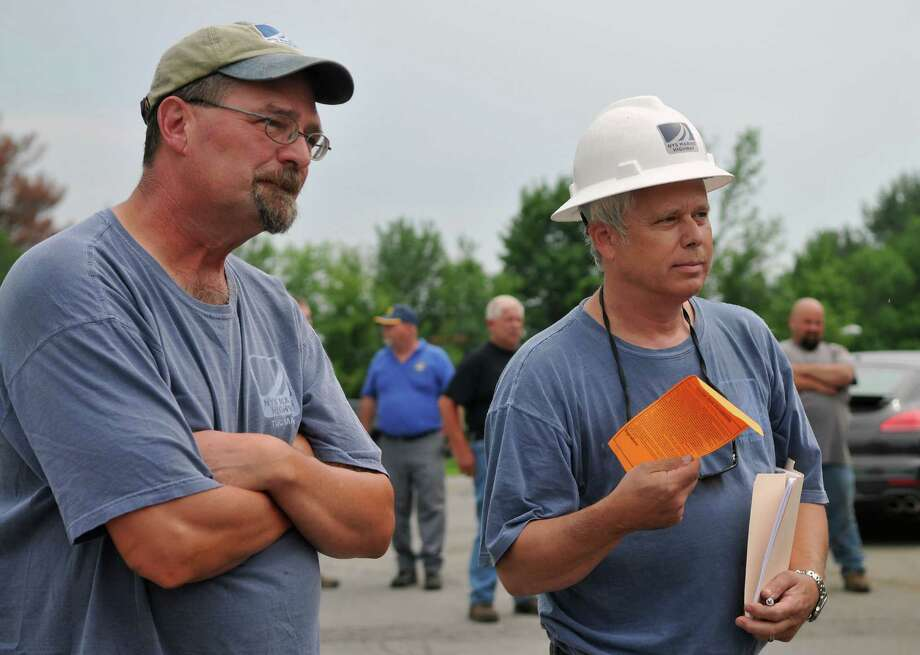 Rob Goldman, right, and Tim Dufel of NY Marine Highway bid on the first canal vessel during an auction for the two New York State Thruway Authority/Canal Corporation canal vessels Thursday, July 9, 2015, at the New York Canals' Waterford Section dry dock in Waterford, N.Y. Goldman won the vessel with a $13,500 bid. (Phoebe Sheehan/Special to The Times Union) Photo: PS / 00032559A