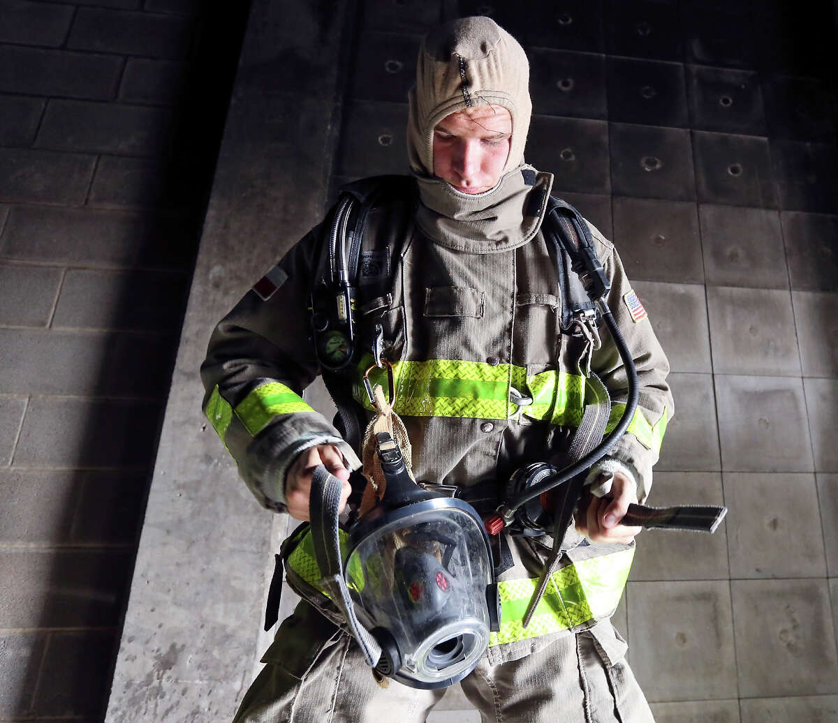 San Antonio Fire Department cadet Christopher Williams prepares to take part in a live fire demonstration with other members of SAFD Cadet Class 2015 Alpha part of the SAFD Cadet Family Night Thursday July 9, 2015 at the SAFD Training Academy.