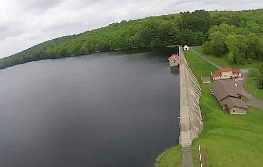 An aerial view of the dam at Hemlock Reservoir, one of the Aquarion Water Co. reservoirs that is a primary source of the public water supply for Fairfield. This image is from a video on YouTube. Photo: Contributed Photo / Contributed Photo / Fairfield Citizen