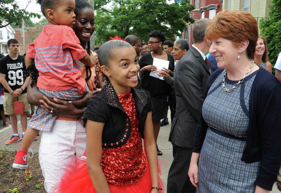 Alana Miles,11, of Troy talks to Albany Mayor Kathy Sheehan during a sidewalk fair to celebrate the new Youth Opportunity Office at 382 Clinton Ave. on Thursday, July 9, 2015 in Albany, N.Y.  (Lori Van Buren / Times Union) Photo: Lori Van Buren / 00032556A
