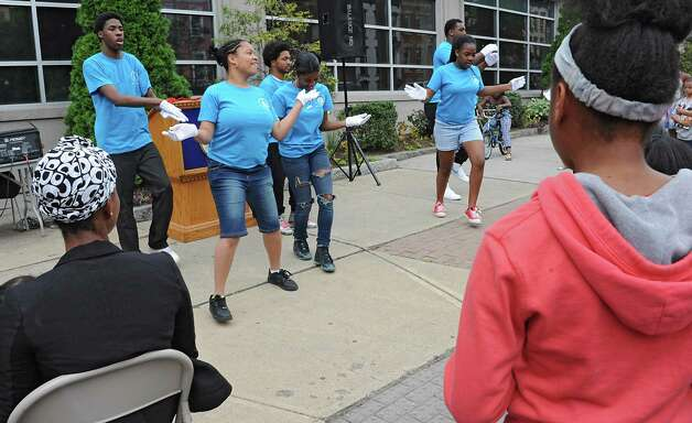 A group from the Sweet Pilgrim Missionary Baptist Church perform a routine during a sidewalk fair to celebrate the new Youth Opportunity Office at 382 Clinton Ave. on Thursday, July 9, 2015 in Albany, N.Y.  (Lori Van Buren / Times Union) Photo: Lori Van Buren / 00032556A