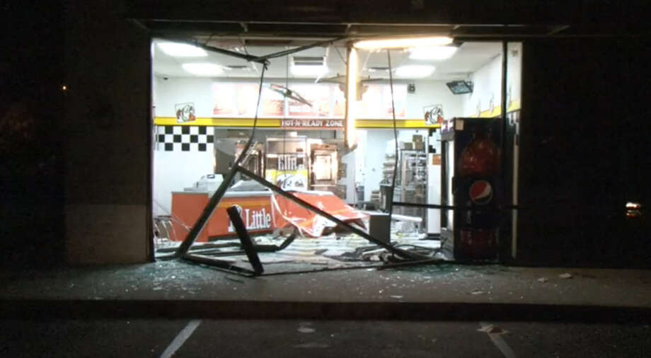Police said suspects rammed a pickup truck into the front of the store, smashing through the glass front doors and windows. A car was seen leaving the store after the break-in. Officers spotted a woman driving the car erratically on the Northwest Freeway near Beltway 8-West and stopped her. Photo: Metro Video