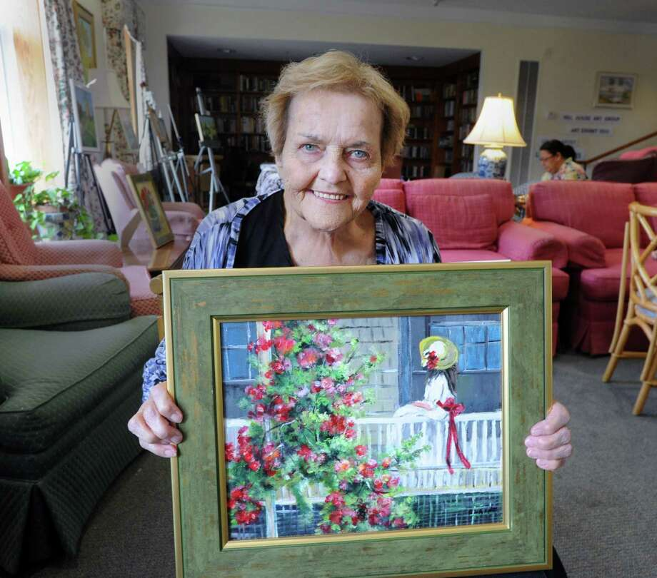 Hill House residents Elaine Sicilian, above, and Caroline Ducibella holds their paintings for the Hill House art show at their senior citizen residency in Greenwich. The exhibit of 30 paintings by fellow residents, including the painting by Emily Reynolds, left, runs until Wednesday, July 15. Photo: Photos By Bob Luckey Jr. / Hearst Connecticut Media / Greenwich Time