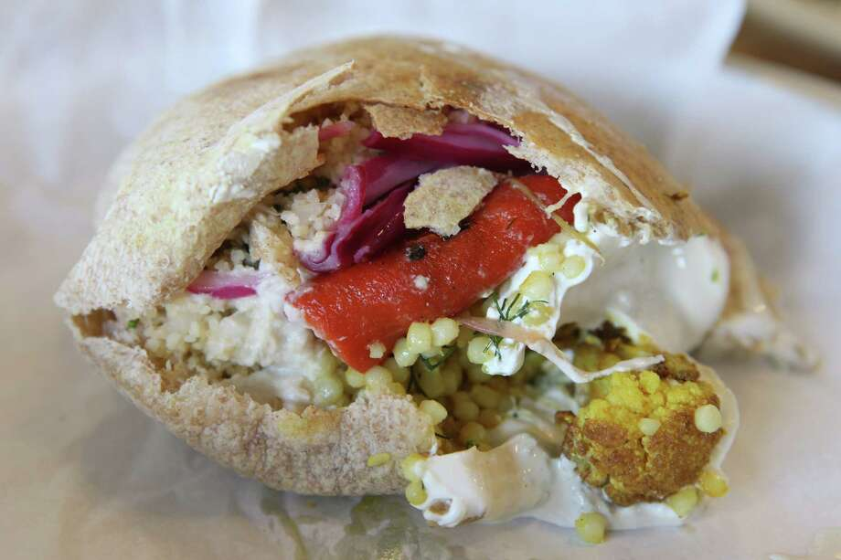 Whoever is working behind the counter — often Weissman or his wife Maureen, will fill your pita or plate with a bounty, often giving suggestions like an extra brushstroke of labneh to help paint the overflowing mouth of the pita shut. Photo: William Luther /San Antonio Express-News / © 2015 San Antonio Express-News