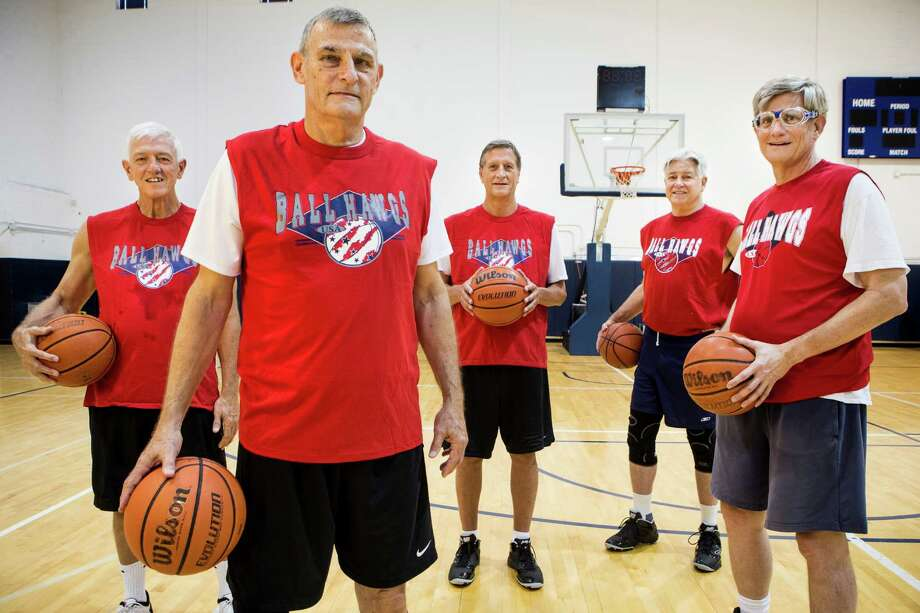 The Ball Hawgs are a 60-64 age group basketball team that has won three National Senior Games championhips. Houston-based players, from left: Greg Layton, John Coles, Clay Hoster, David Gibbs and Steve Gilliland. Photo: Brett Coomer, Staff / © 2015 Houston Chronicle