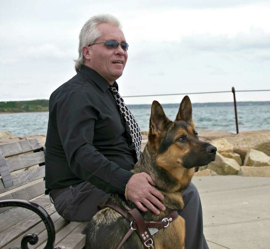 Ray Collins is the Grand Marshal of Fidelco's Fifth Annual Ride for Independence. Collins, who served in the United States Marine Corps, lost his eyesight after an automobile accident in 1986. He's been working with Fidelco Guide Dogs for nearly 30 years and currently works with guide dog 'Bob.'Contributed, Fidelco Photo: /