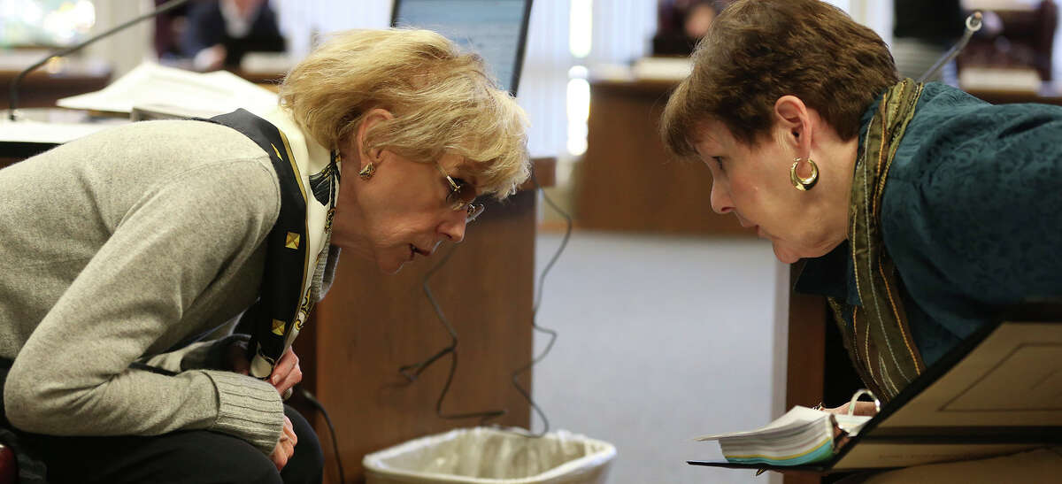 State Board of Education members Geraldine Miller, R-Dallas, and Patricia Hardy, R-Fort Worth, exchange views between their desks during public comments before their vote on new history and social studies textbooks in November, 2014.