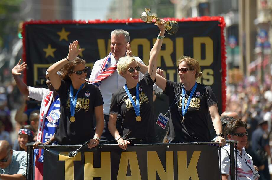 (Left to right): Chirlane McCray, soccer player Carli Lloyd Mayor Bill de Blasio, soccer player Megan Rapinoe and U.S. Coach Jill Ellis aboard a float in the New York City Ticker Tape Parade for World Cup Champions U.S. Women's Soccer National Team on July 10, 2015 in New York City. Photo: Michael Loccisano, Getty Images