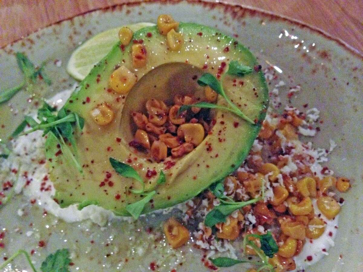 Avocado with corn salad, lime, cilantro, cotija cheese and crema at Saltair Seafood Kitchen, 3029 Kirby. (Photo: Greg Morago)
