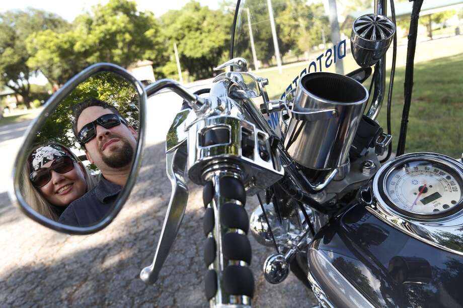 William and Morgan English with their Yamaha motorcycle, photographed on Tuesday, June 9, 2015, in Brenham. They were on site during the shootout at Twin Peaks in Waco, and both spent multiple days in jail They had just pulled up to the restaurant when the shooting started. ( Karen Warren / Houston Chronicle ) Photo: Houston Chronicle