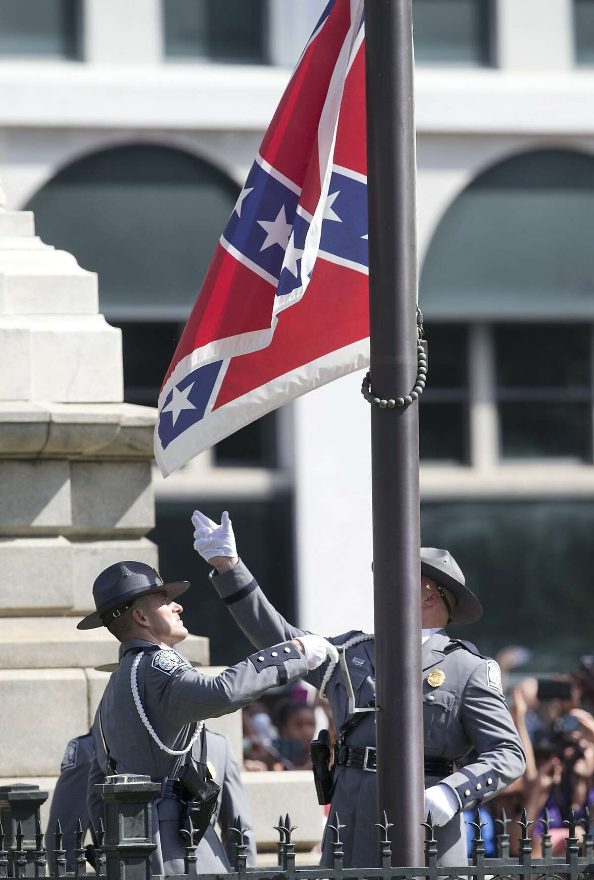 An honor guard from the South Carolina Highway patrol removes the Confederate battle flag from the Capitol grounds Friday, July 10, 2015, in Columbia, S.C. (AP Photo/John Bazemore)