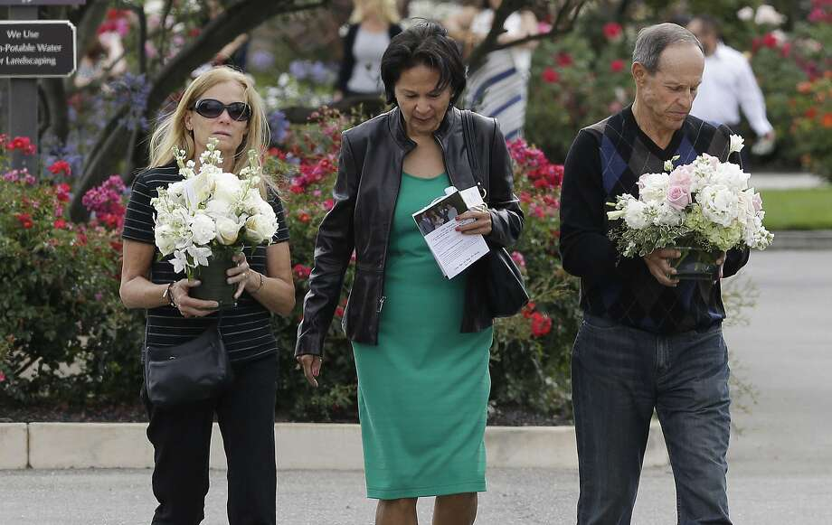 Two women and a man walk toward the parking lot after a memorial service for Kathryn Steinle in Pleasanton, Calif., Thursday, July 9, 2015. Steinle, of San Francisco, was gunned down by Juan Francisco Lopez Sanchez on July 1 while walking along a city pier with her father. (AP Photo/Jeff Chiu) Photo: Jeff Chiu, Associated Press