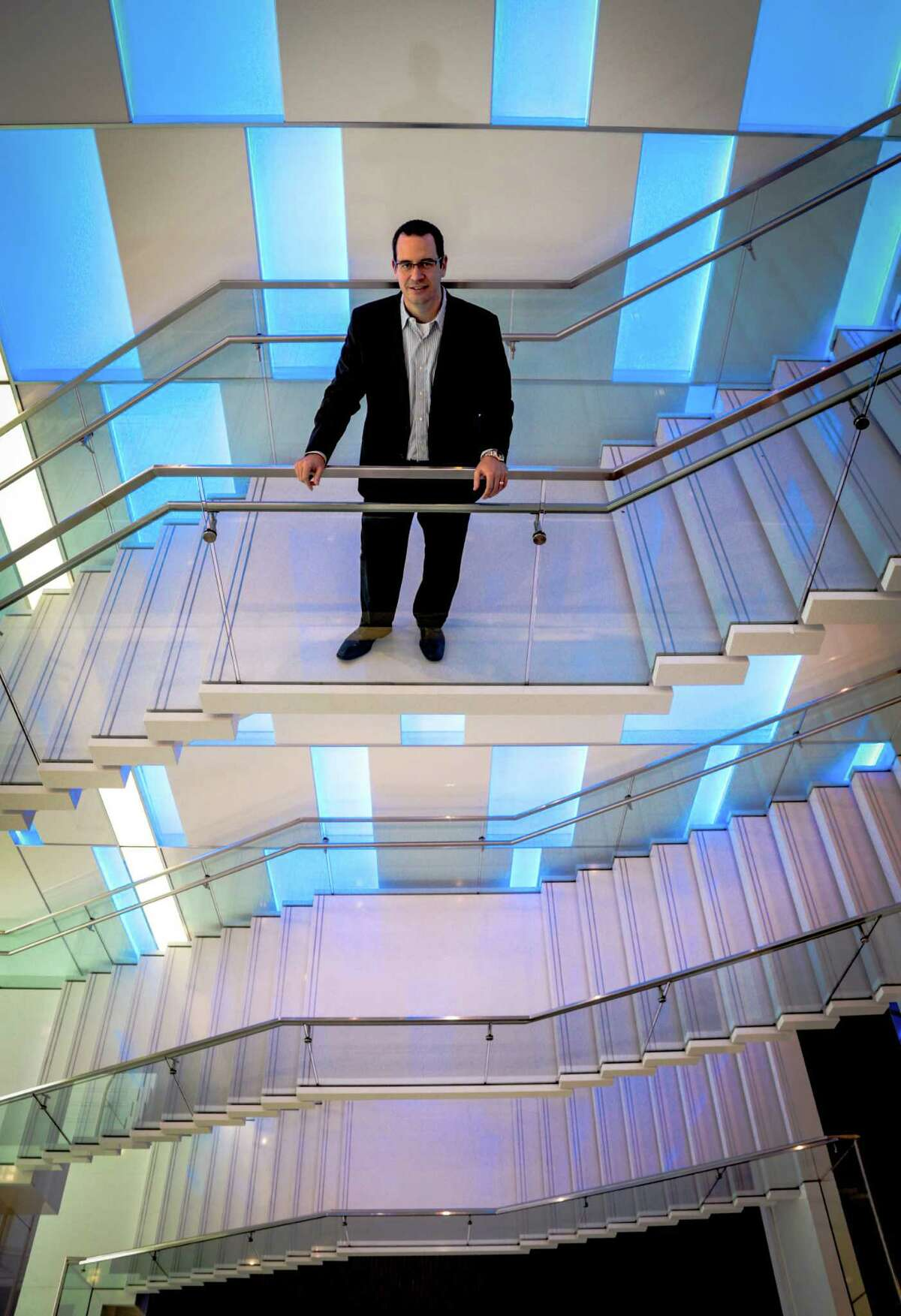 Jeremy Fingeret, senior managing director of Houston-based alliantgroup at the company's headquarters, Wednesday July 8. 2015. Alliantgroup's building opened in January of 2014 and they occupy the top floors, 17 through 20, and are in the process of building out the 16th floor with a gym. Alliantgroup helps small to mid-size businesses take advantage of tax credits such as the 179D tax credit for energy-efficient buildings. As one of the few LEED Platinum buildings in Houston, their offices showcase the latest in energy efficiency and design as a nice work environment for employees. Floor-to-ceiling windows, coated with a film to keep the heat out and the cool air in, allow natural light for workers to enjoy. The offices are in the middle of the building so everyone has access to the natural light. LEED is the U.S. Green Building Council's certification for green buildings and stands for