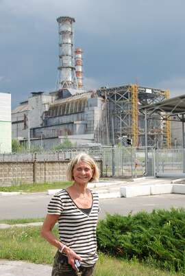 Denise Vouri, of Concord, in Chernobyl in front of former nuclear power plant.