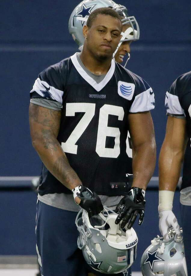 Dallas Cowboys defensive end Greg Hardy (76) takes off his helmet during an NFL football minicamp at the team's stadium in Arlington, Texas, Wednesday, June 17, 2015. Photo: LM Otero /Associated Press / AP