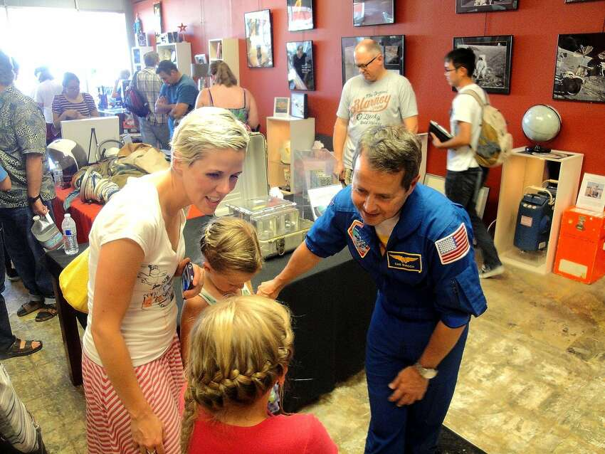 Astronaut Dan Bursch with young visitors at the Novato Space Festival in 2014.