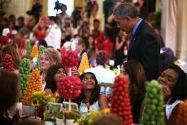 "WASHINGTON, DC - JULY 10: U.S. President Barack Obama drops by and greets attendees during the annual ''Kids' State Dinner'' in the East Room at the White House July 10, 2015 in Washington, DC. President Obama dropped by the ""dinner"" as the first lady hosted the 2015 winners of the Healthy Lunchtime Challenge, a nationwide recipe challenge for kids that promotes cooking and healthy eating. (Photo by Alex Wong/Getty Images)"