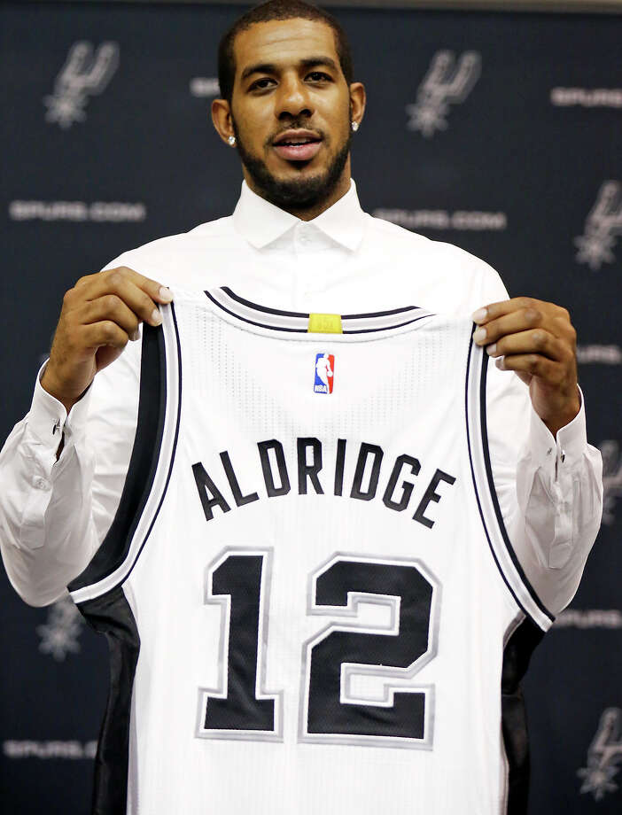 San Antonio Spurs' LaMarcus Aldridge poses for photos with his jersey during a press conference at the Spurs practice facility Friday July 10, 2015 where he was officially introduced. Photo: Edward A. Ornelas, San Antonio Express-News / © 2015 San Antonio Express-News