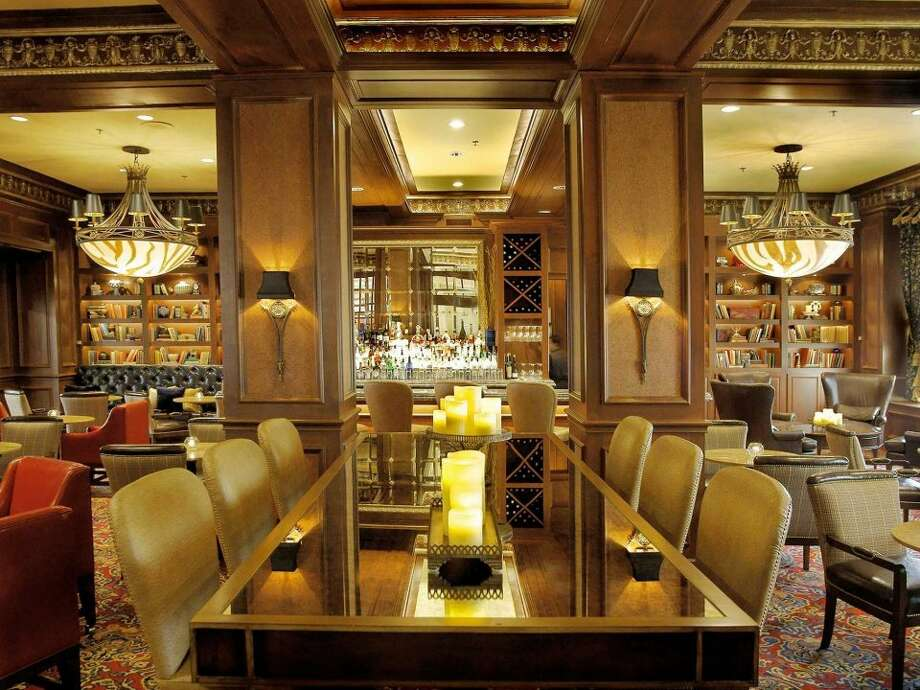 The Library Bar at the Warwick Melrose Hotel (Dallas, TX)  Built in 1924, Dallas' Warwick Melrose Hotel is dripping in southern charm. The main artery of the elegant hotel is the Library Bar, which hosts local singers six nights a week.  Saddle up on the mirrored bar or find a cozy chair in the book nook and sip a cooling Aperol Spritz or maple- and bourbon-spiked 'Til Morning cocktail. The whiskey menu boasts Macallan 25-year and the wine list features 27 wines by the glass.  3015 Oak Lawn Ave., Dallas, TX, 214-521-5151 Photo: Courtesy Photo/Business Insider