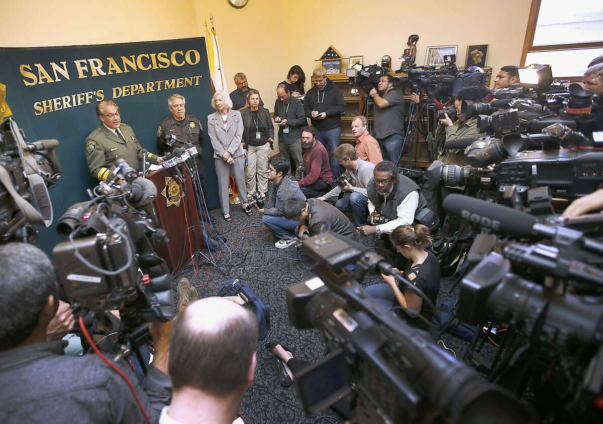 San Francisco Sheriff Ross Mirkarimi, at podium, speaks during a news conference, Friday, July 10, 2015, in San Francisco. Mirkarimi provided information regarding the April 2015 release of Juan Francisco Lopez-Sanchez, who is now accused in the shooting death of a woman at a popular tourist site. (AP Photo/Tony Avelar)
