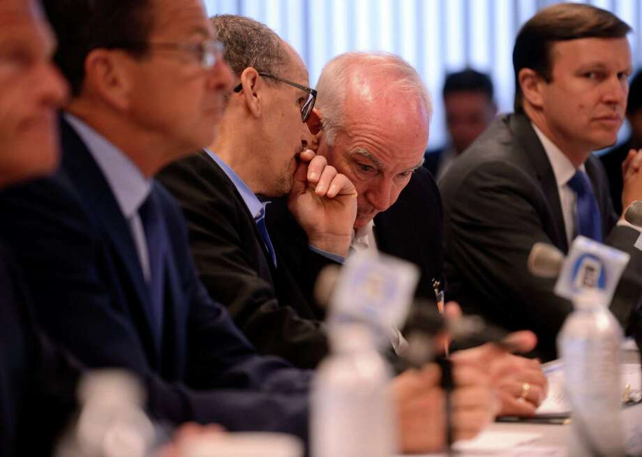 U.S. Secretary of Labor Thomas Perez, left, turns to exchange comments with Congressman Joe Courtney, D-2nd District, during a roundtable discussion of manufacturing labor force issues in the region Thursday, May 28, 2015 at General Dynamics Electric Boat in Groton, Conn. The panel also included U.S. Senators Richard Blumenthal and Chris Murphy, D-Conn., and Connecticut Gov. Dannel Malloy. (AP Photo/The Day, Sean D. Elliot) Photo: Sean D. Elliot / Associated Press / THE DAY