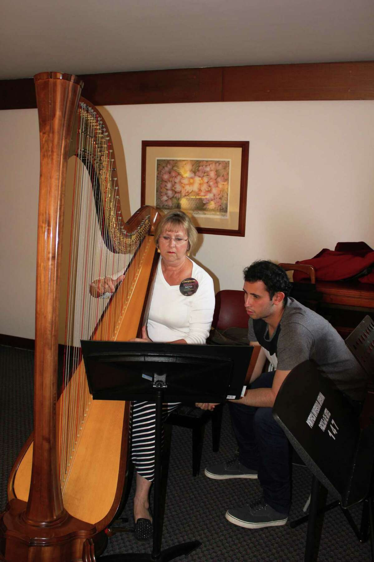Former Houston Symphony principal harpist Paula Page works with Daniel Amezquita of the Colombian Youth Philharmonic during a weeks-long residency in Paipa, Colombia.