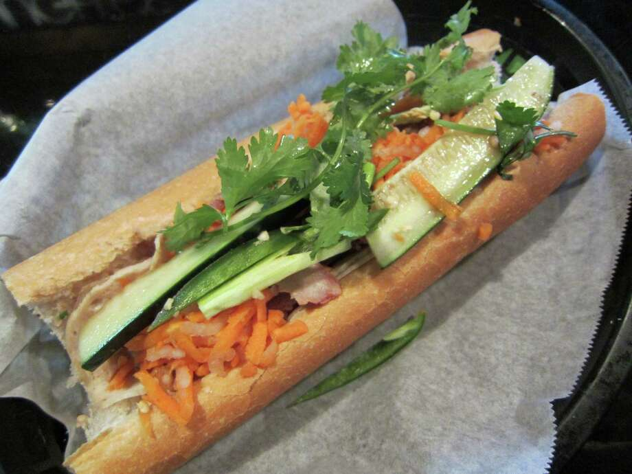 The dish: banh mi ($5)The place: Hughie's Tavern & VietnameseThe address: 1802 W. 18thInformation: 713-869-1830; hughiesgrille.comClick here for original story. Photo: Syd Kearney