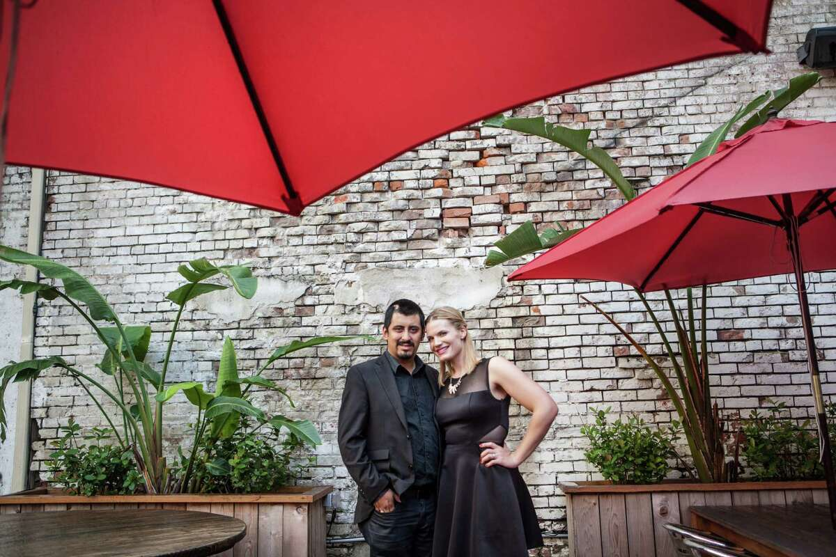 Chef David Guerrero and his wife, Gillian Givens, pose for a portrait outside Batanga Restaurant. Guerrero, who owns Andes Cafe, had recently undergone suregery to remove a second brain tumor and a fundraiser was being held for him at the restaurant. (Michael Starghill, Jr.)