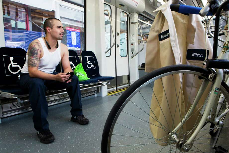 Eduardo Trevino sold his car because he prefers to travel to his destinations using the Metro Rail and his bicycle. Trevino works in the Medical Center, and was headed there on Friday via the Green Line. Photo: Marie D. De Jesus, Houston Chronicle / © 2015 Houston Chronicle