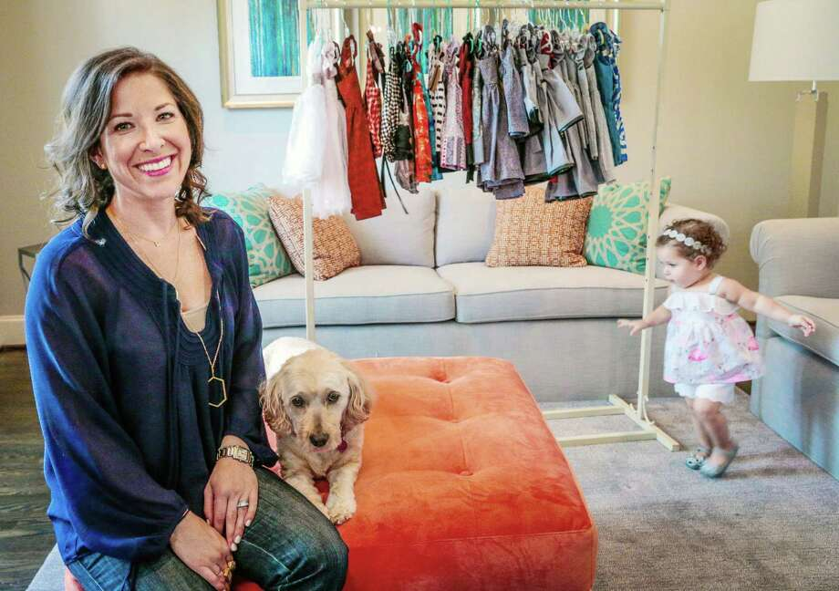 Esther Freedman with her 18-month old daughter Naomi at their home in Bellaire,Texas, Wednesday July 9, 2015.  Freedman launched her line in 2012, selling from her website at cuteheads.com. (Billy Smith II / Houston Chronicle) Photo: Billy Smith II, Staff / © 2015 Houston Chronicle