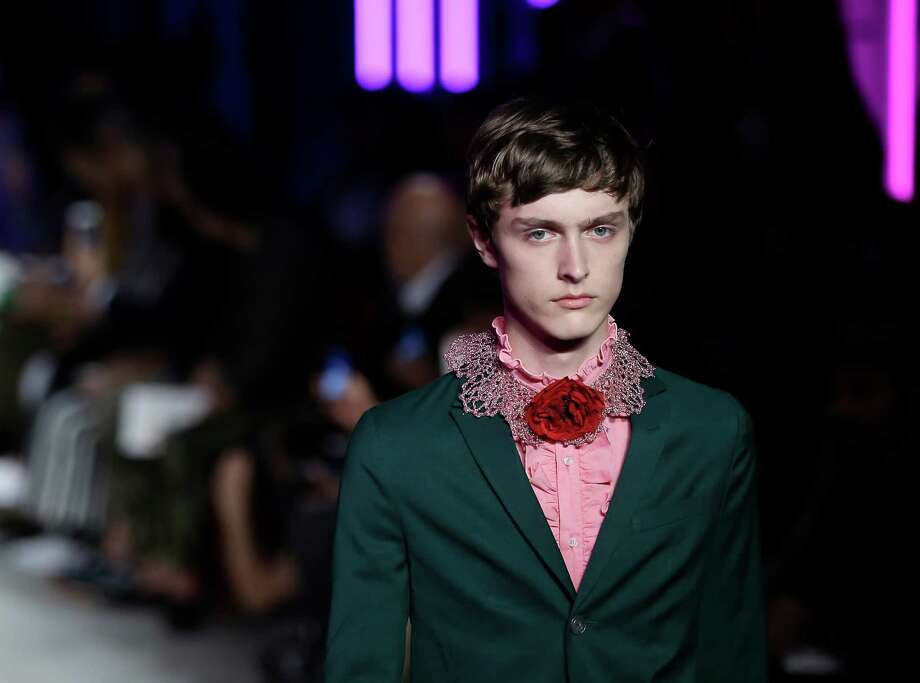 Models wear feminine creations for Gucci men's spring-summer 2016 collection at Milan Fashion Week. Photo: Antonio Calanni, STF / AP