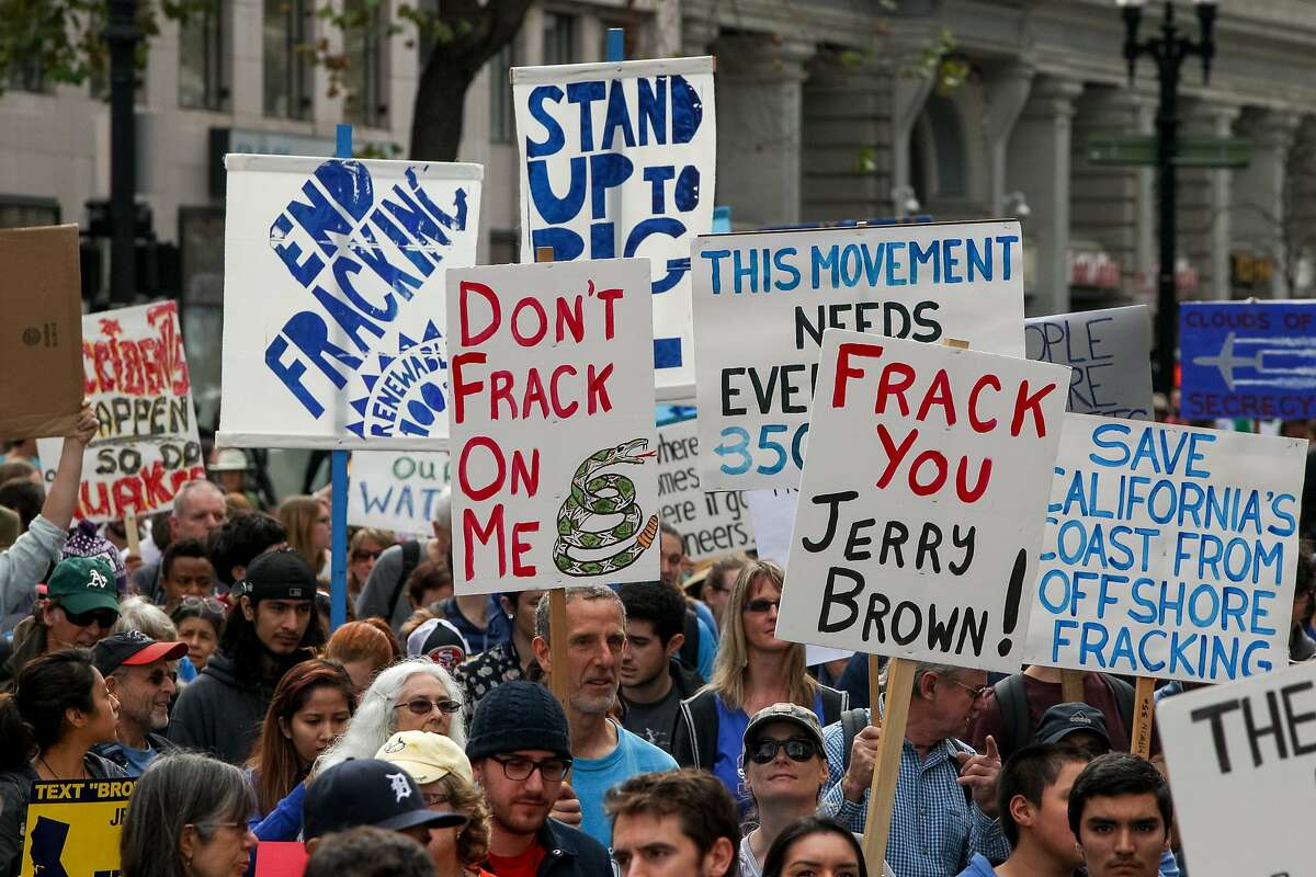 Protesters against fracking rallied at Frank H. Ogawa Plaza and marched for two miles to Lake Merritt Boulevard, Saturday, Feb. 7, 2015, in Oakland, Calif.