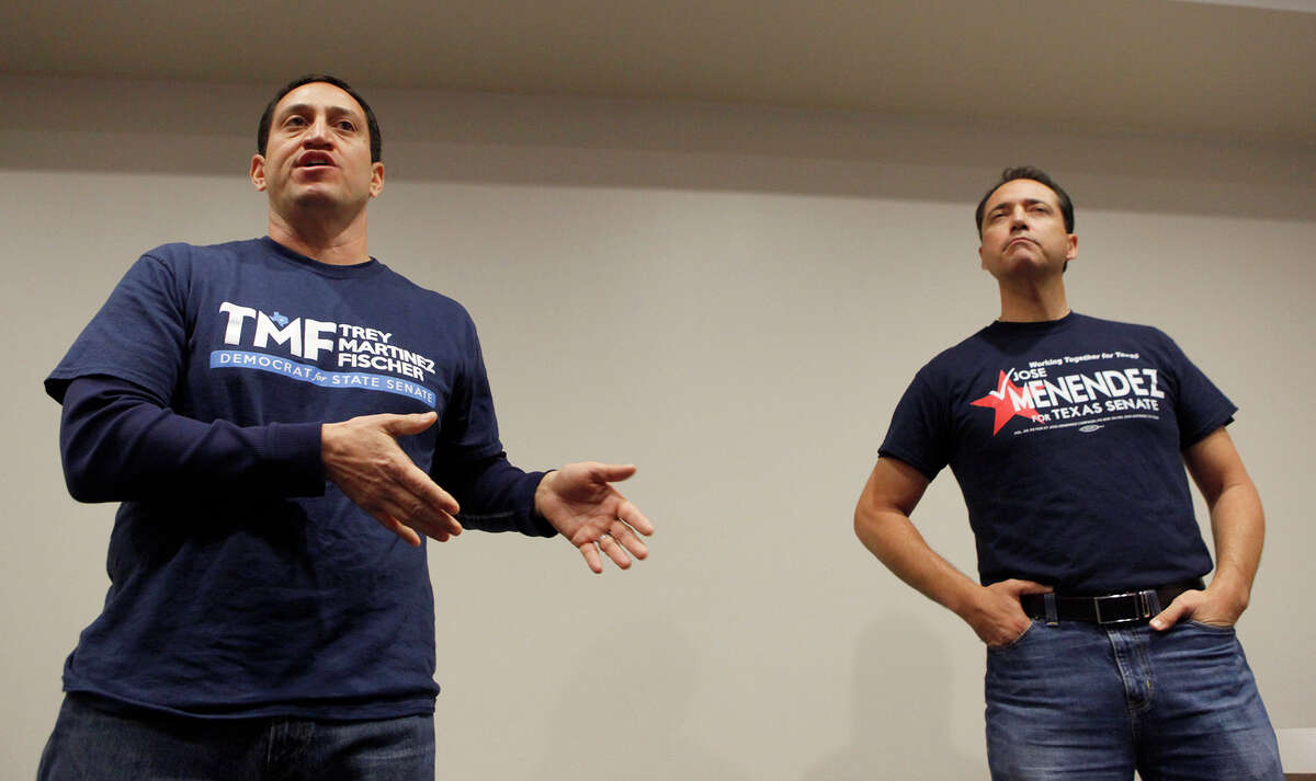 State Sen. Jose Menendez (right) and state House Rep. Trey Martinez Fischer (left) speak during a meeting of the Northeast Bexar County Democrats on Saturday Feb. 7, 2015. Martinez Fischer is challenging Menendez again for the Senate District 26 seat after losing in a run off election last year.