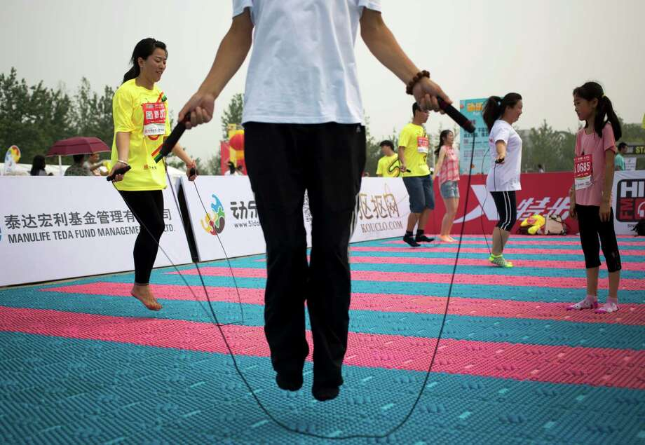 150 minutes of moderate exercise can keep cholesterol in check. Photo: Andy Wong, STF / AP