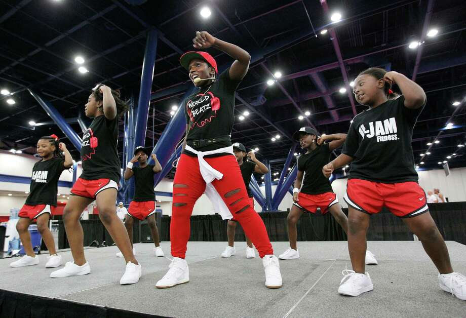 U-Jam fitness instructor Denitra Bruer-Robinson performs a hip-hop routine during a stop in Houston. U-Jam is one of the hot trends in fitness classes. Photo: Billy Smith II, Staff / © 2014 Houston Chronicle
