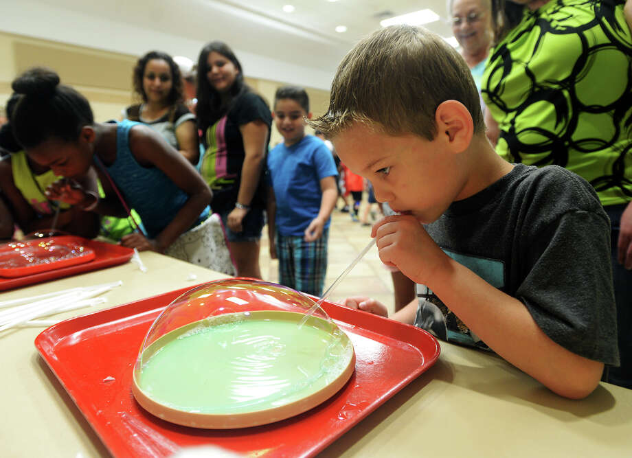 """FRIDAY: """"BUBBLE DAY""""When:July 8, 10:30 a.m .- noonWhere:Rogers park Community Center, 1455 Dowlen Rd., BeaumontCost:FreeInfo:409-833-5100/www.texasenergymuseum.org Photo: Jake Daniels / ©2015 The Beaumont Enterprise/Jake Daniels"""