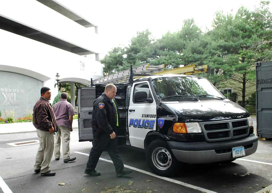 Stamford police investigators at XL Capital's offices at Seaview House in October 2009, where officers converged after a gun-wielding assailant attacked a manager there. Photo: File Photo