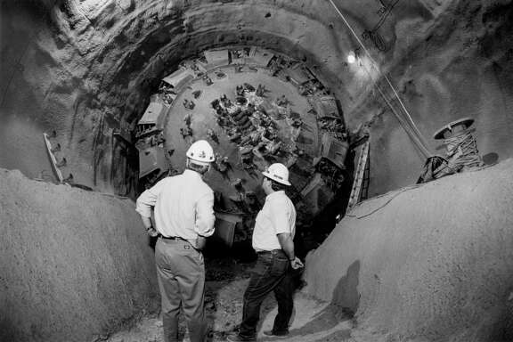 Army Corps of Engineers officials survey the giant boring device  that drilled through earth  150 feet below the surface in  1991. The  San Antonio River Tunnel was completed in 1997.