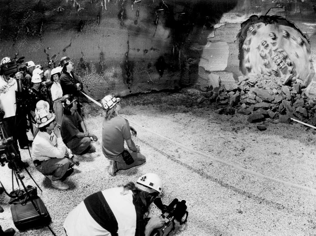 Members of the media and workers for the Obayashi Corporation witness the boring through of the San Antonio River Tunnel on March 16, 1992.