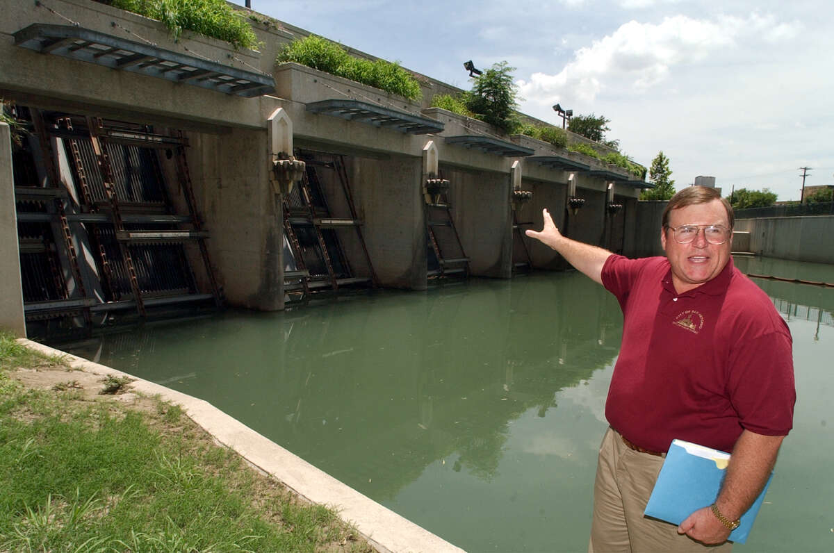 Tom Wendorf, then director of public works, shows the San Antonio River Tunnel inlets in 2002.