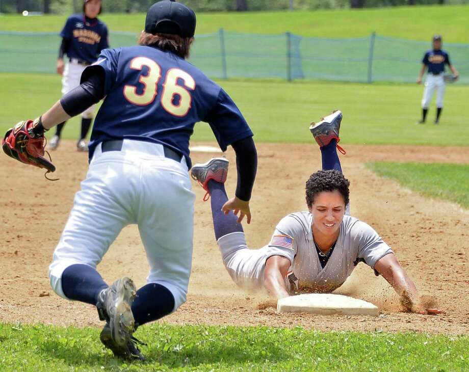USA Baseball Women's National Team's #6 Malaika Underwood slides into third to beat the throw to Japan's Madonna Stars's #36 Ayako Rokkaku, left, for a triple in the opening game of the Cooperstown Women's Baseball Classic Friday July 10, 2015 at SUNY in Cobleskill, NY.   (John Carl D'Annibale / Times Union) Photo: John Carl D'Annibale / 00032552A