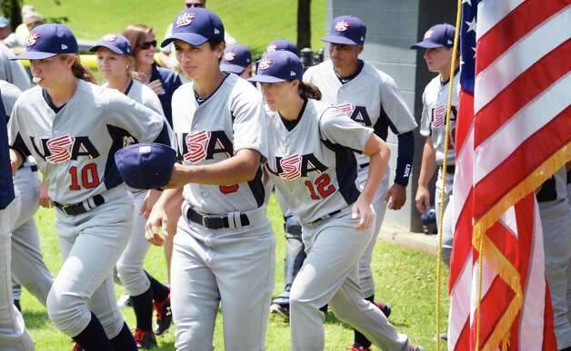 Members of the USA Baseball WomenOs National Team take the field at the start of the opening game of the Cooperstown WomenOs Baseball Classic against JapanOs Madonna Stars Friday July 10, 2015 at SUNY in Cobleskill, NY.   (John Carl D'Annibale / Times Union) Photo: John Carl D'Annibale / 00032552A
